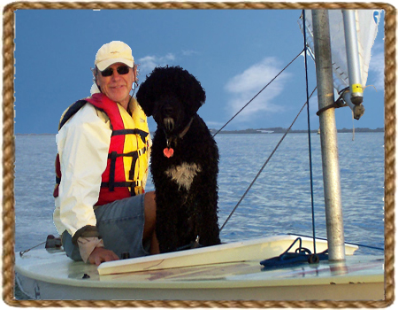 Brian and his dog on sailboat at Anna Maria Island, FL